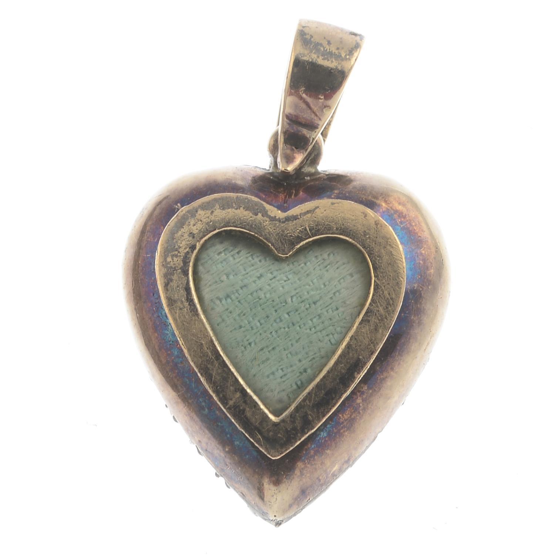 Lot 29 - An emerald and diamond heart locket pendant.Estimated total diamond weight 0.75ct.Length 2.3cms.