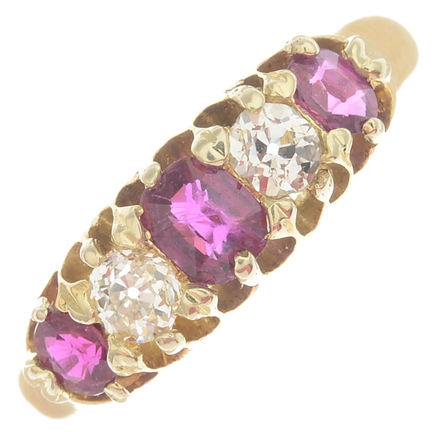 Lot 4 - A late Victorian 18ct gold ruby and old-cut diamond five-stone ring.Principal ruby calculated