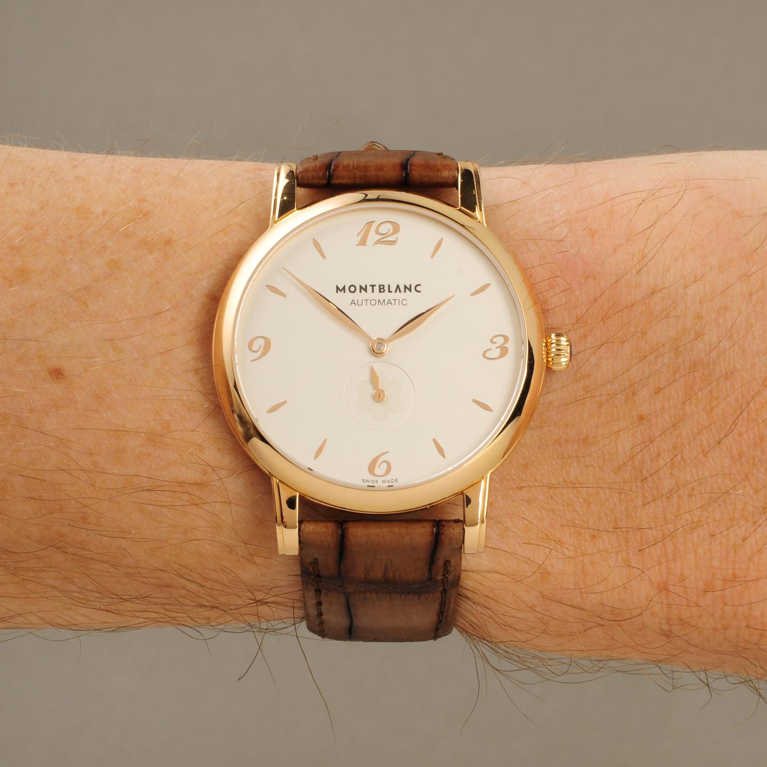 Lot 179 - MONTBLANC - a gentleman's Star Classique wrist watch. 18ct rose gold case with exhibition case back.