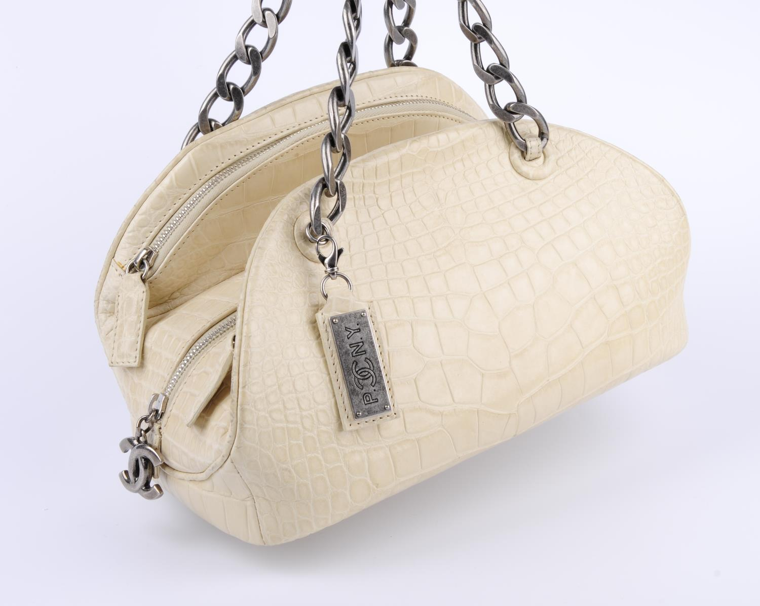 Lot 41 - CHANEL - a Paris New York Alligator Bowling handbag.