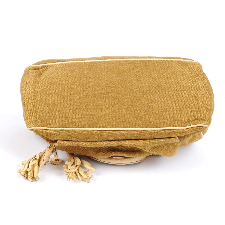 Lot 39 - CÉLINE - a canvas Boogie handbag.