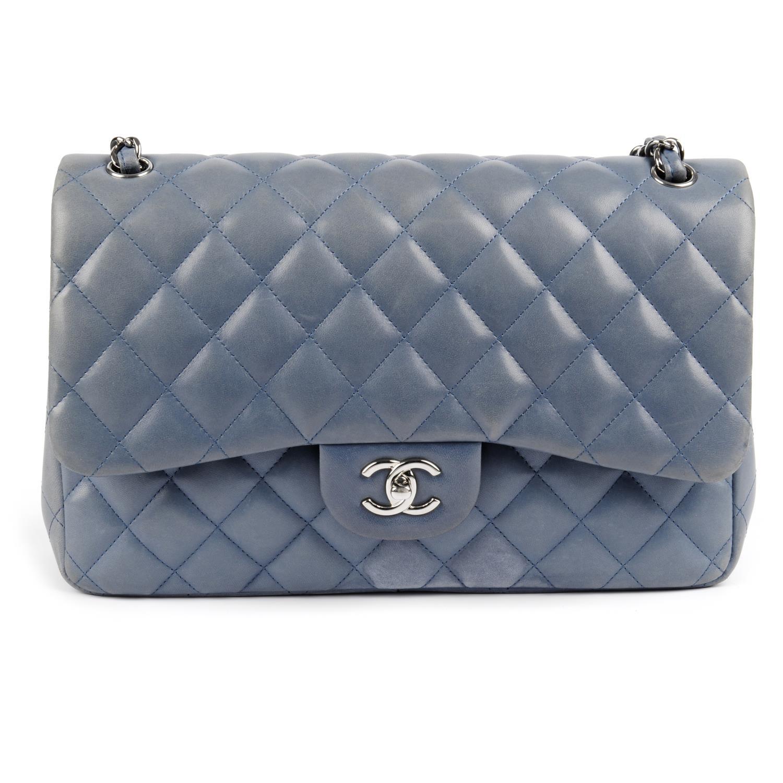 Lot 46 - CHANEL - a light blue Jumbo Classic Double Flap handbag.