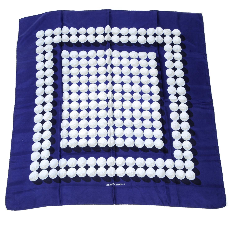 Lot 172 - HERMÈS - a golf scarf.