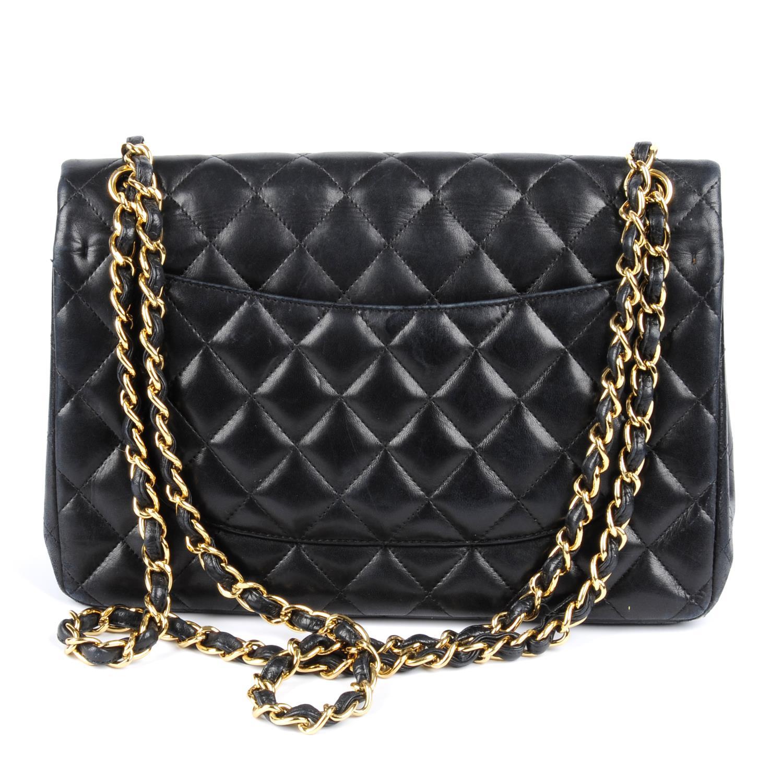 Lot 54 - CHANEL - a Jumbo Classic Double Flap handbag.