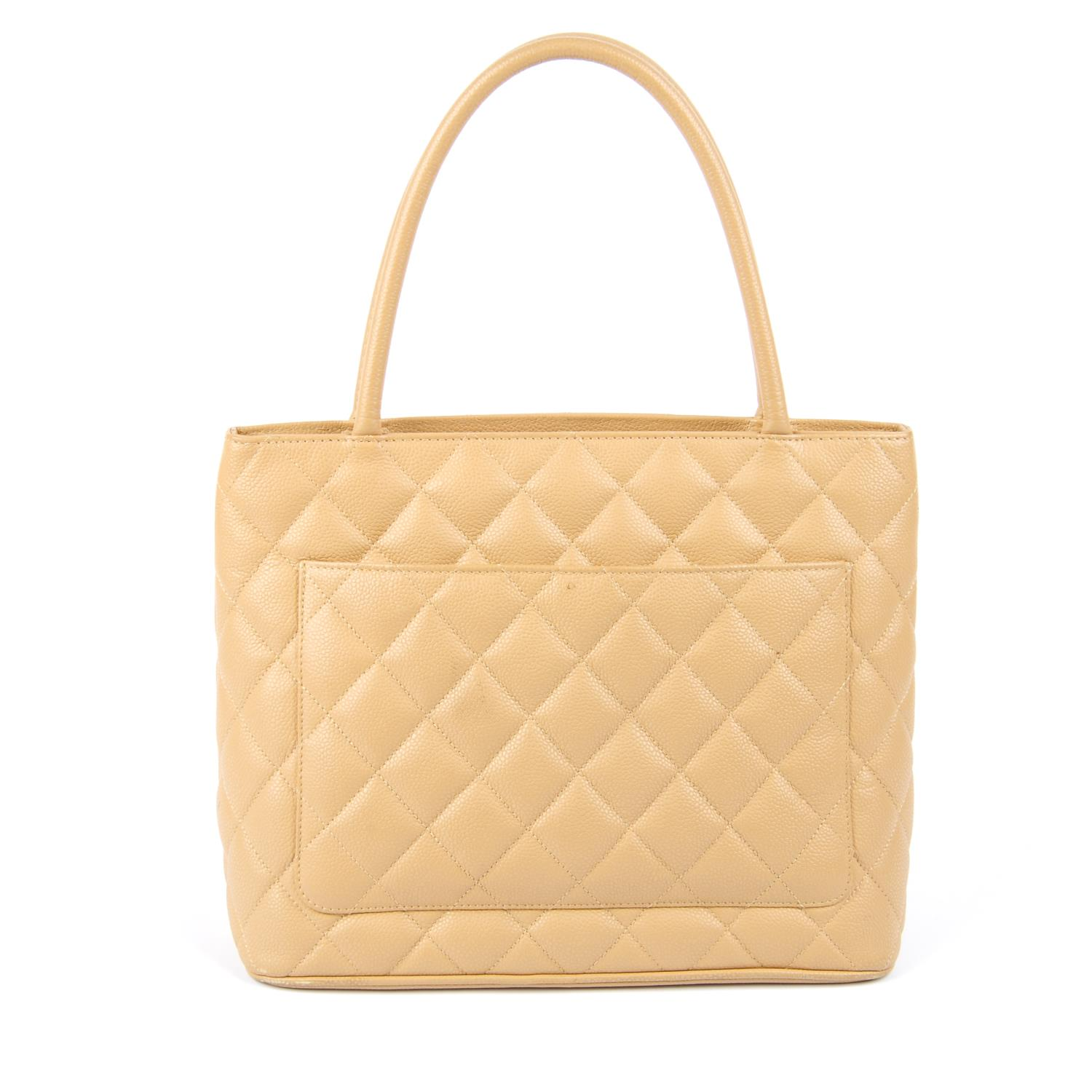 Lot 60 - CHANEL - a Medallion Tote.
