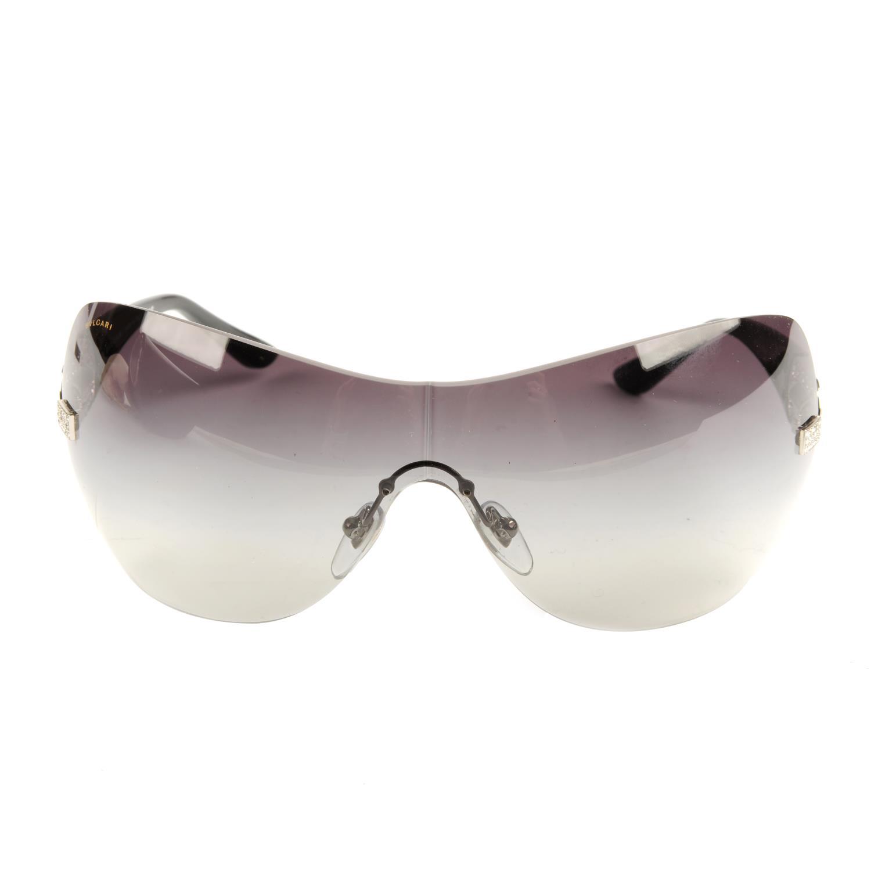 Lot 12 - BULGARI - a pair of large rimless sunglasses.