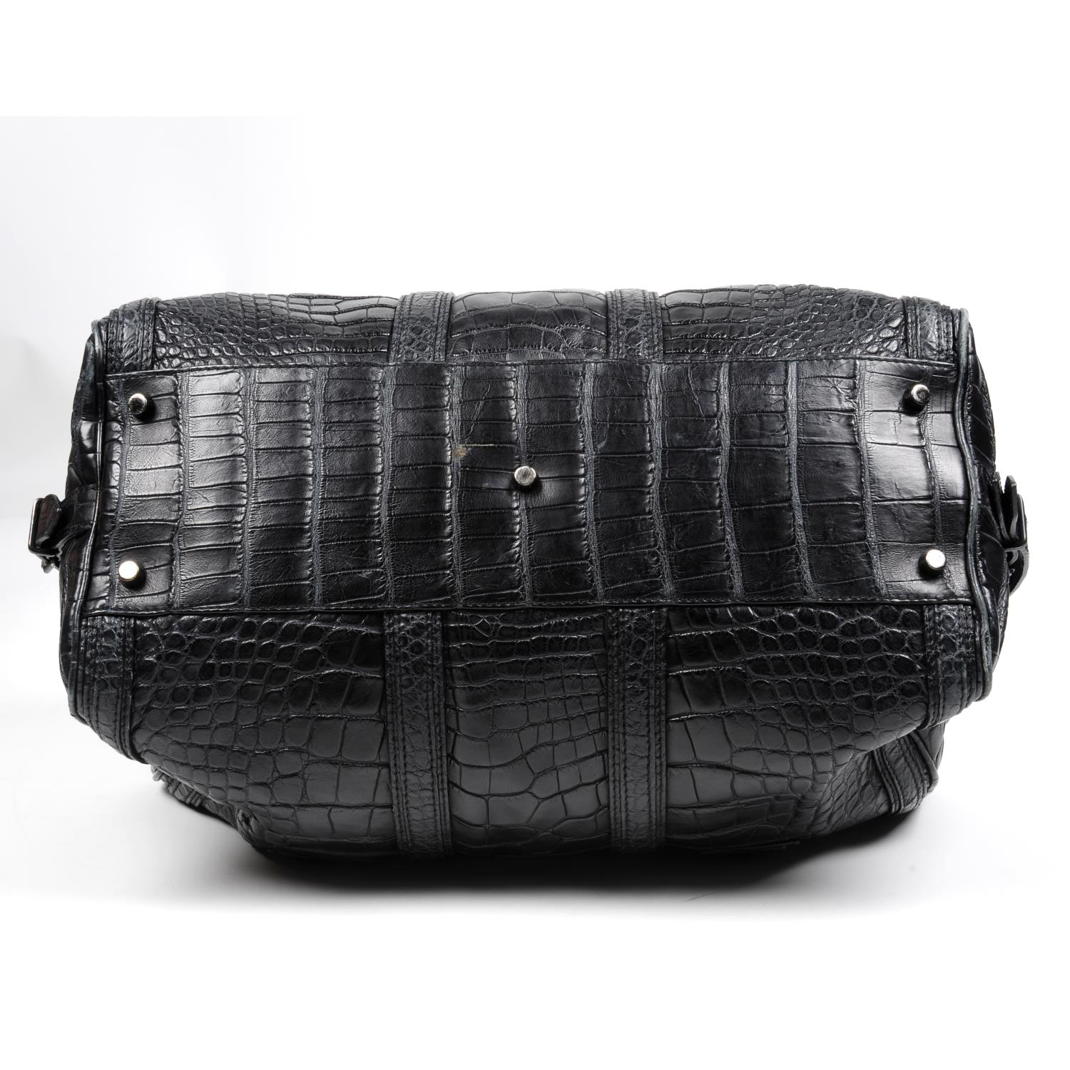 Lot 13 - BURBERRY - a dark navy alligator holdall travel bag.