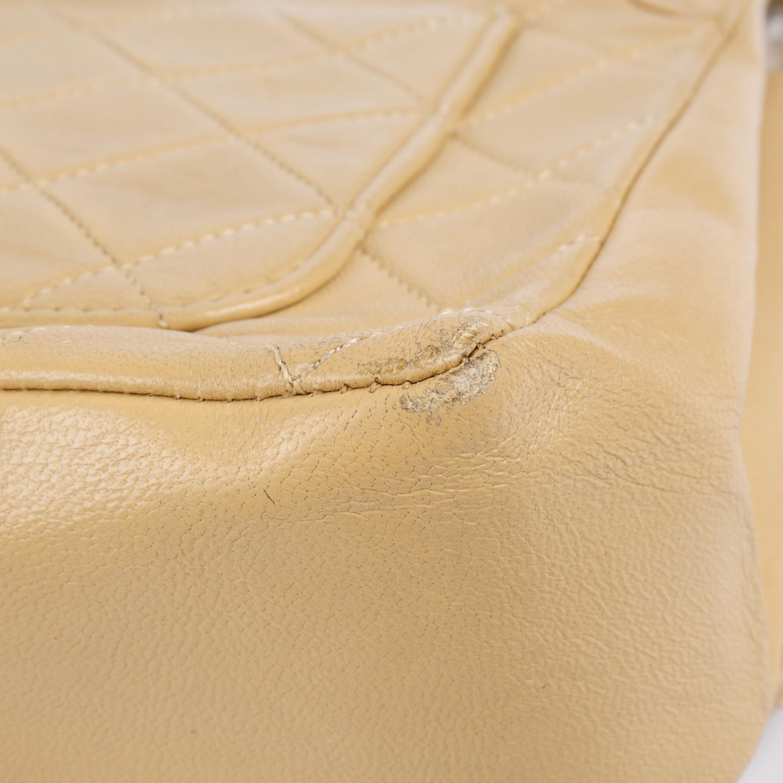Lot 48 - CHANEL - a vintage beige leather handbag.