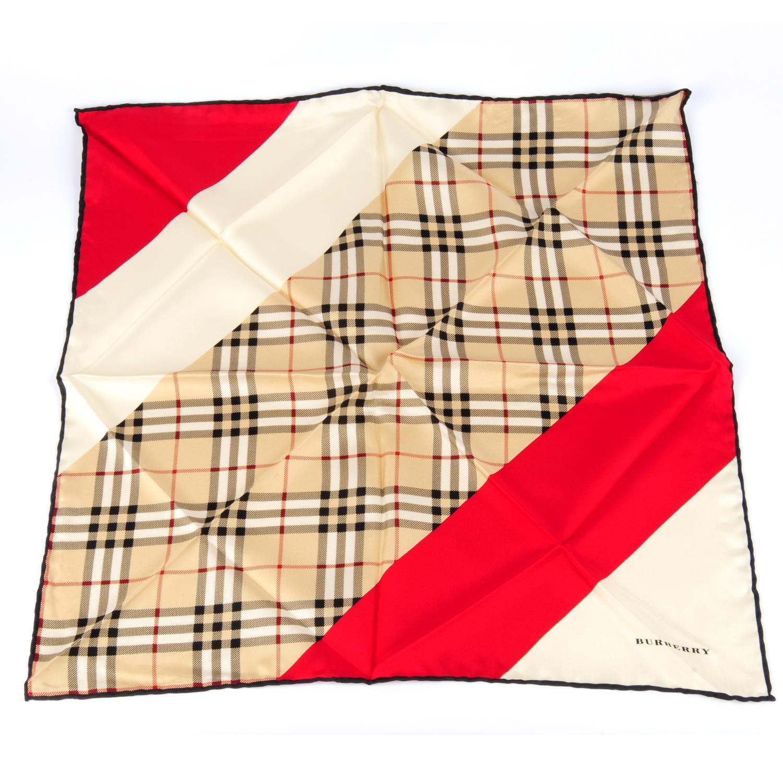 Lot 24 - BURBERRY - a mini silk scarf.