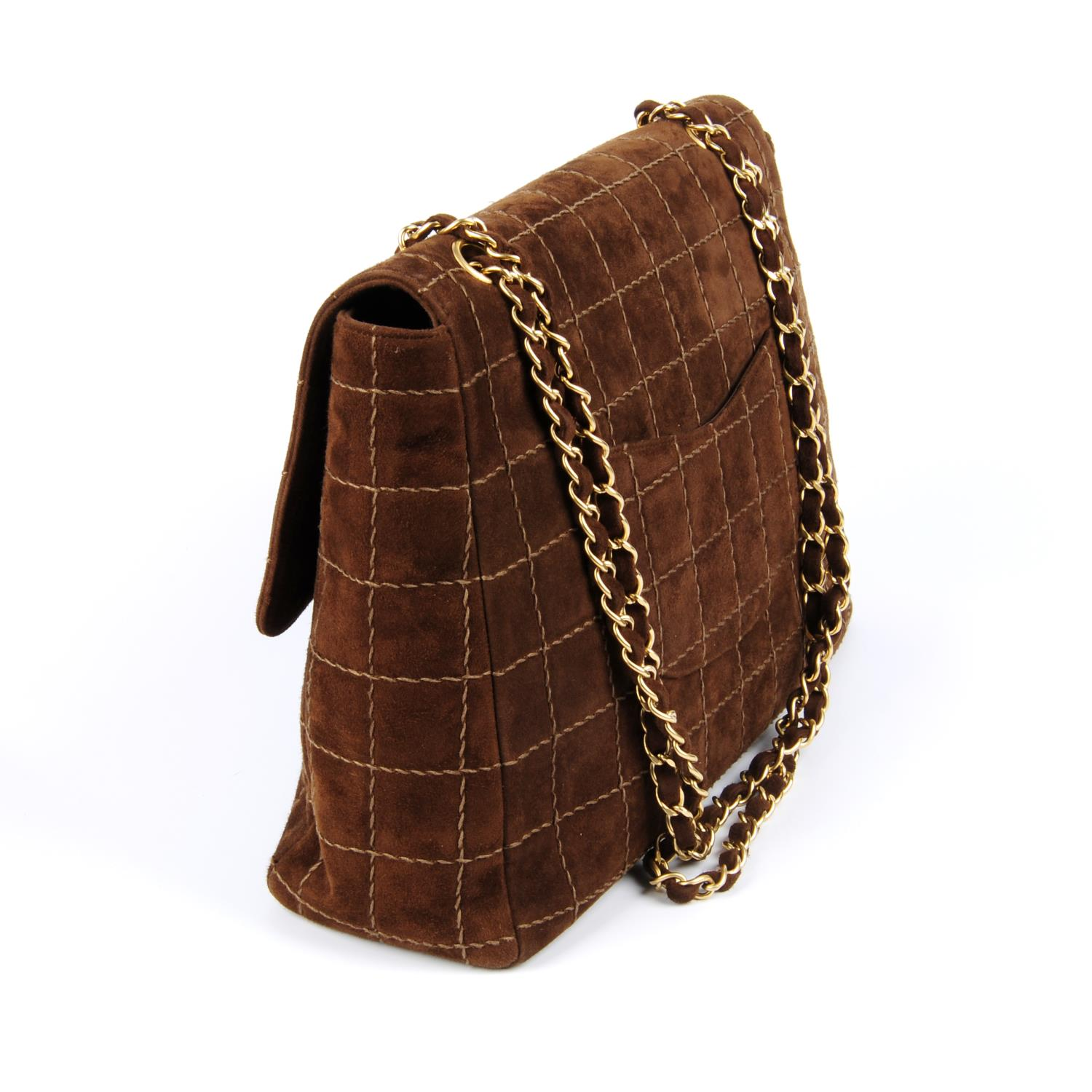 Lot 51 - CHANEL - a brown suede handbag.