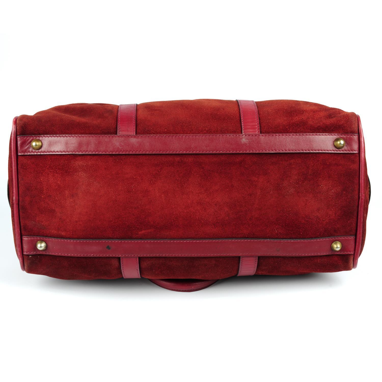 Lot 26 - CARTIER - a vintage Bordeaux Must De Cartier duffle bag.
