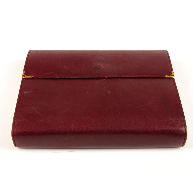 Lot 31 - CARTIER - a Bordeaux leather address book journal.