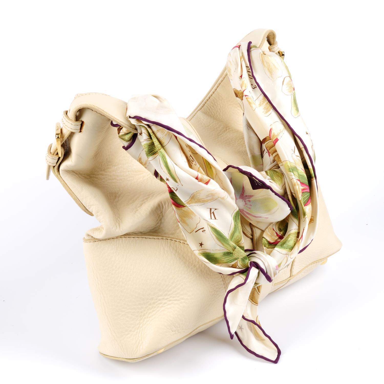 Lot 7 - ASPREY - a cream handbag with scarf handle.