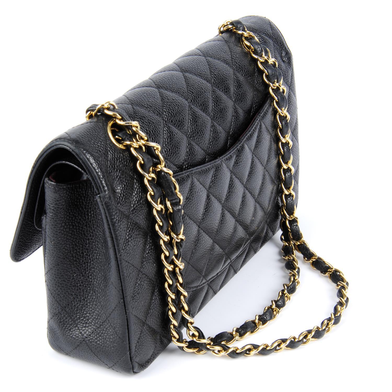 Lot 55 - CHANEL - a caviar Medium Classic Double Flap handbag.