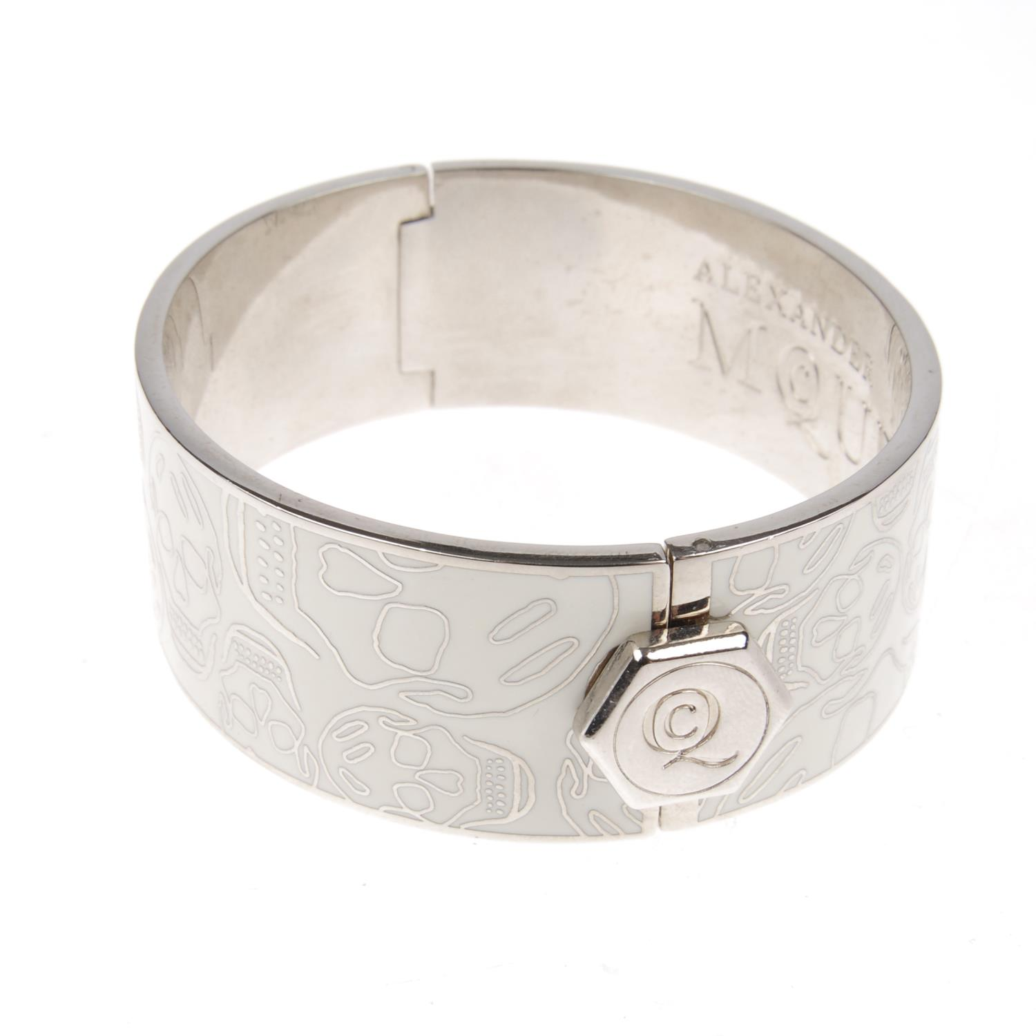 Lot 2 - ALEXANDER MCQUEEN - a skull enamel bangle.