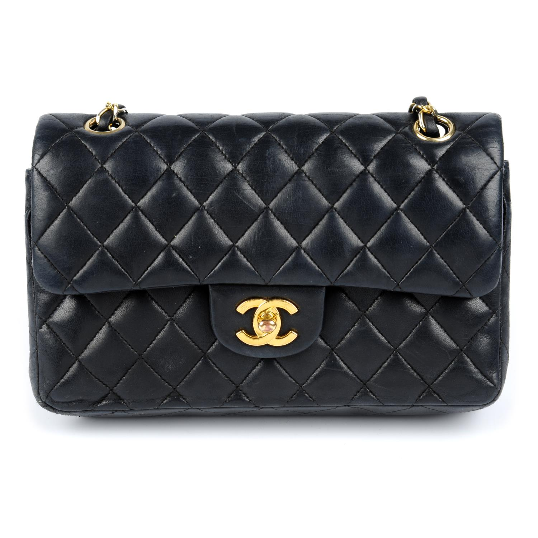 Lot 58 - CHANEL - a Small Classic Double Flap handbag.