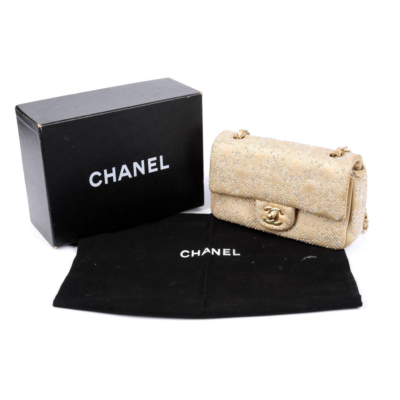 Lot 50 - CHANEL - a 'New Mini' Beaded Flap handbag.