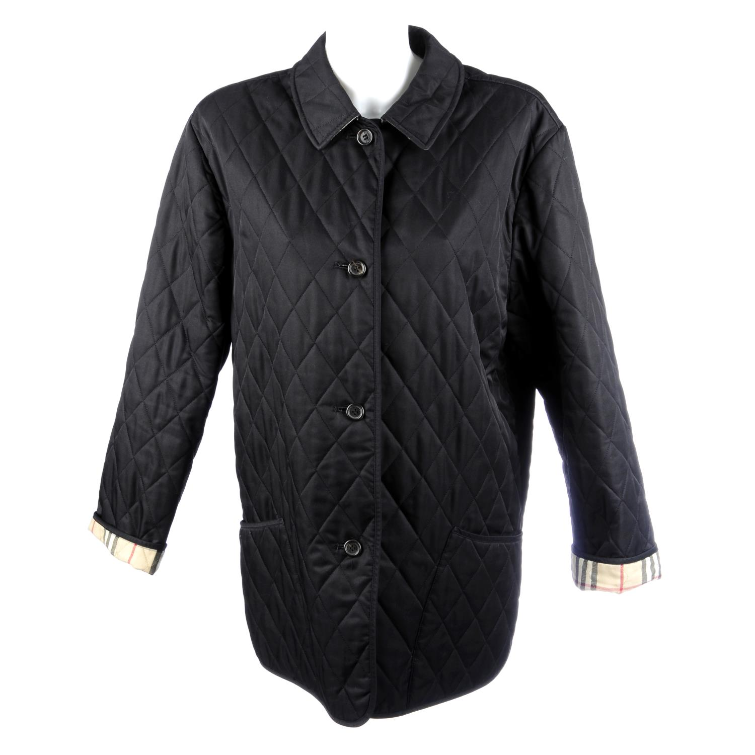 Lot 21 - BURBERRY - a woman's black quilted jacket.
