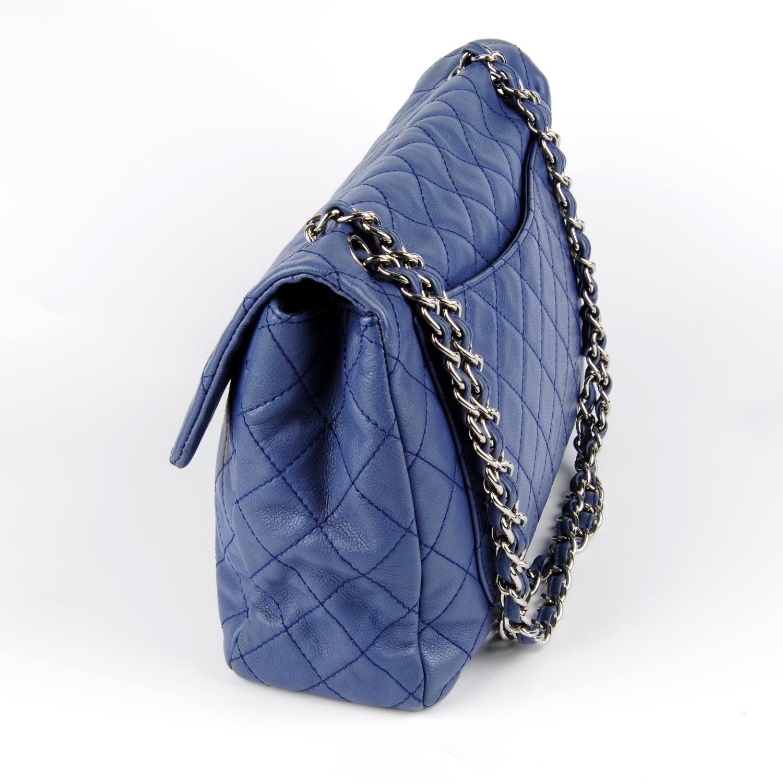 Lot 47 - CHANEL - a blue Jumbo Single Flap handbag.