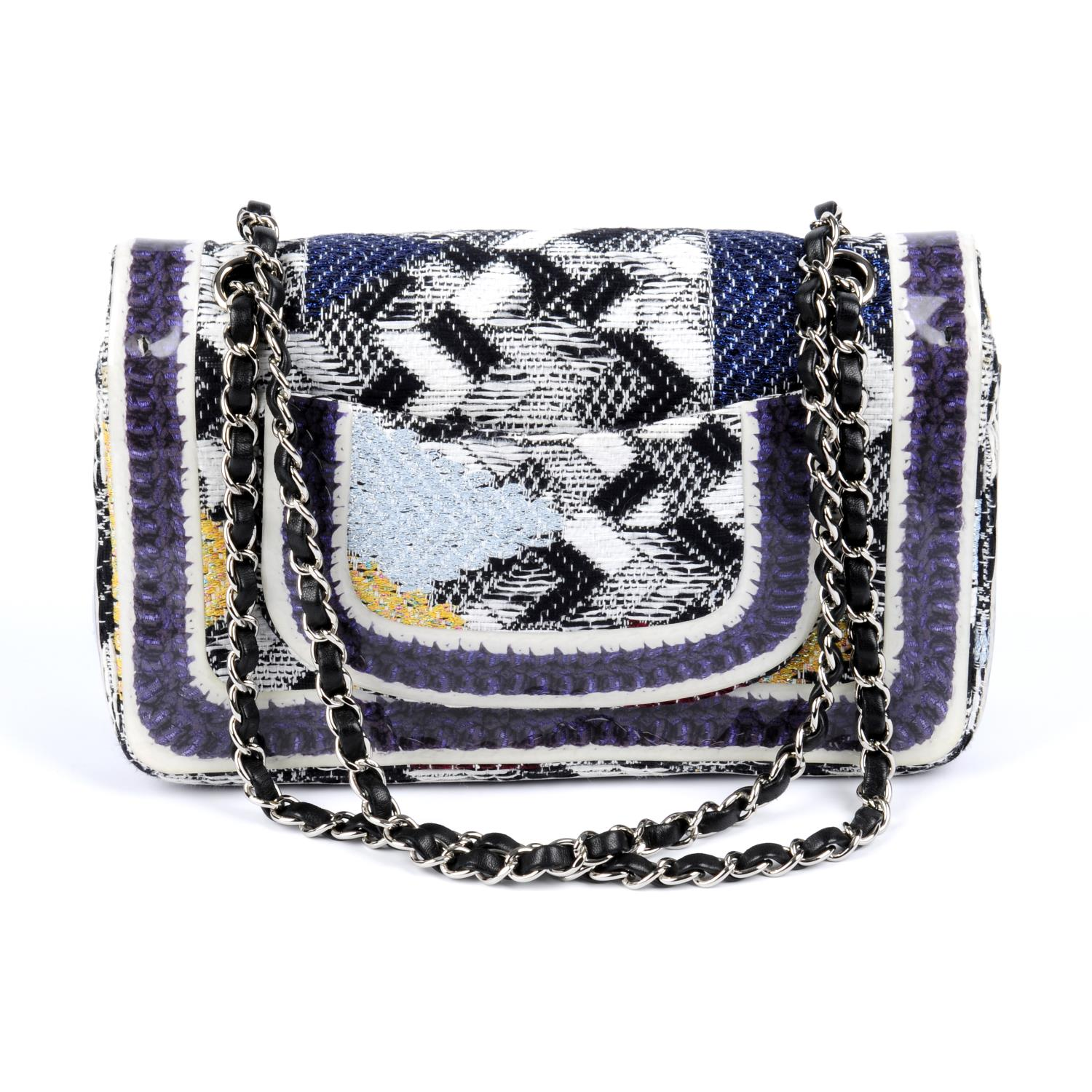 Lot 42 - CHANEL - a Silicone-Covered Tweed Double Flap handbag.
