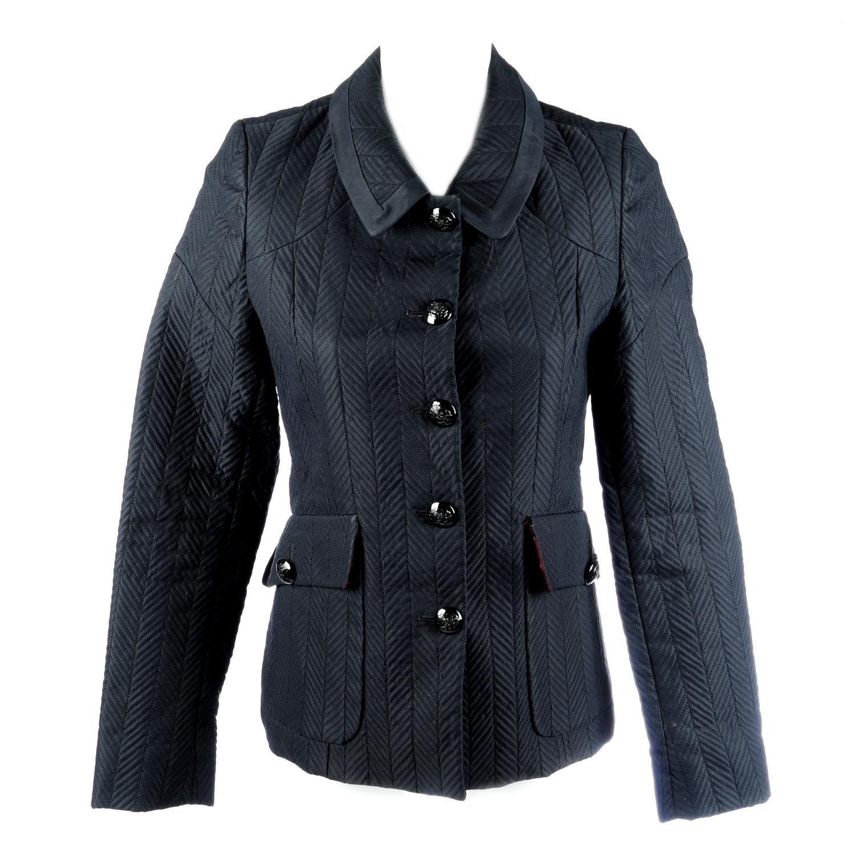 Lot 22 - THOMAS BURBERRY - a black nylon chevron quilted jacket.