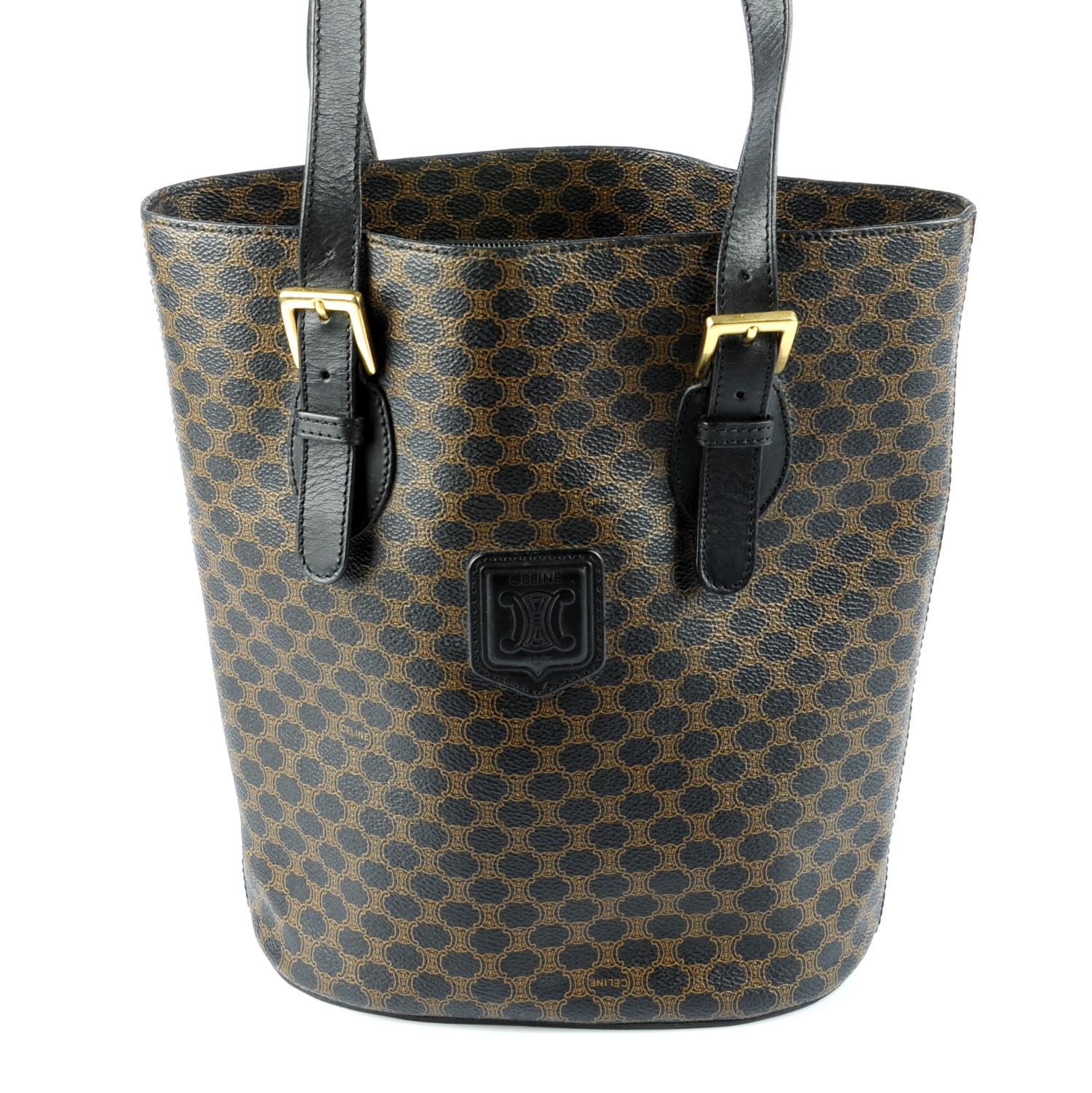 Lot 38 - CÉLINE - a Macadam coated canvas bucket handbag.