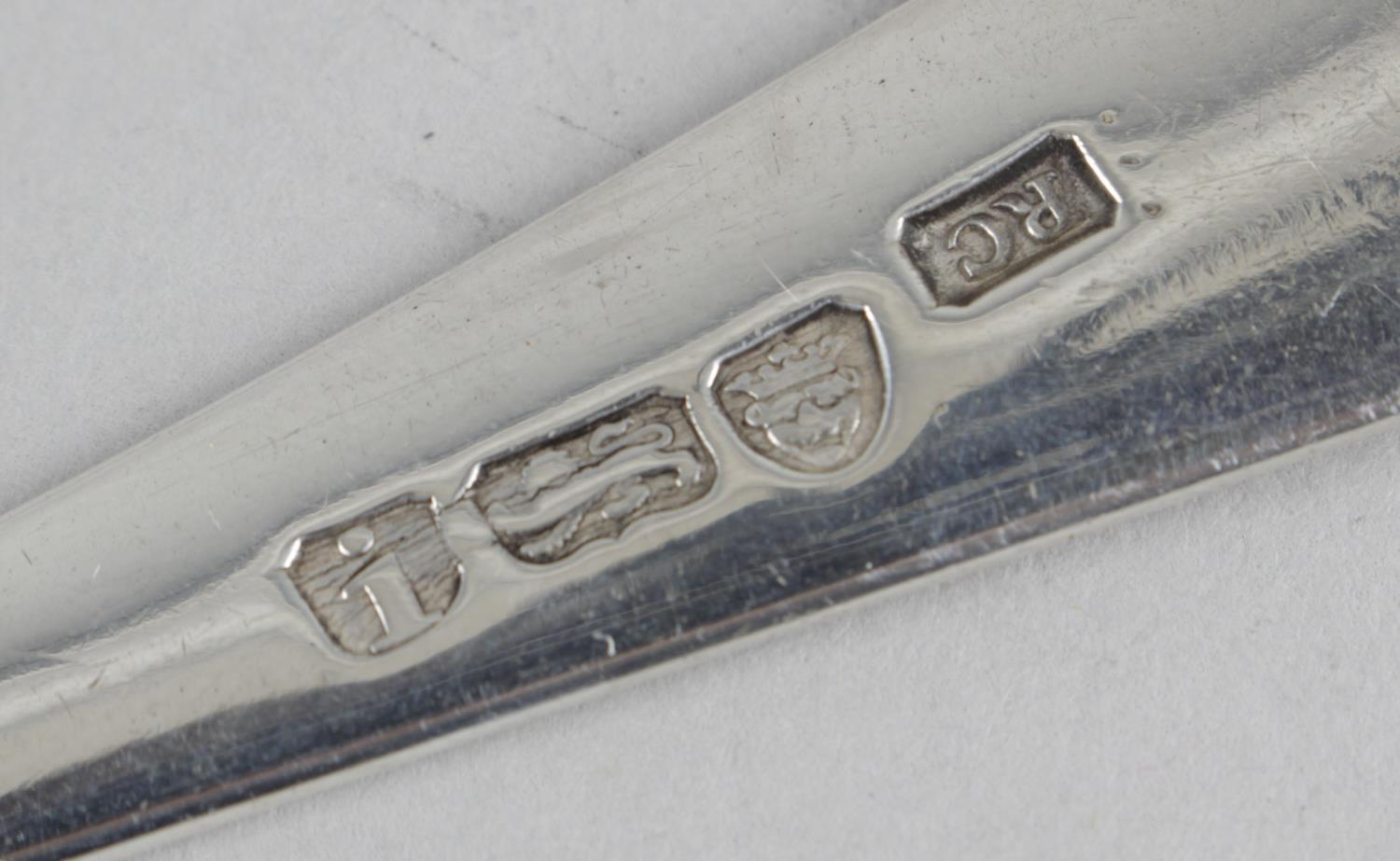 Lot 68 - Two George III silver table spoons,