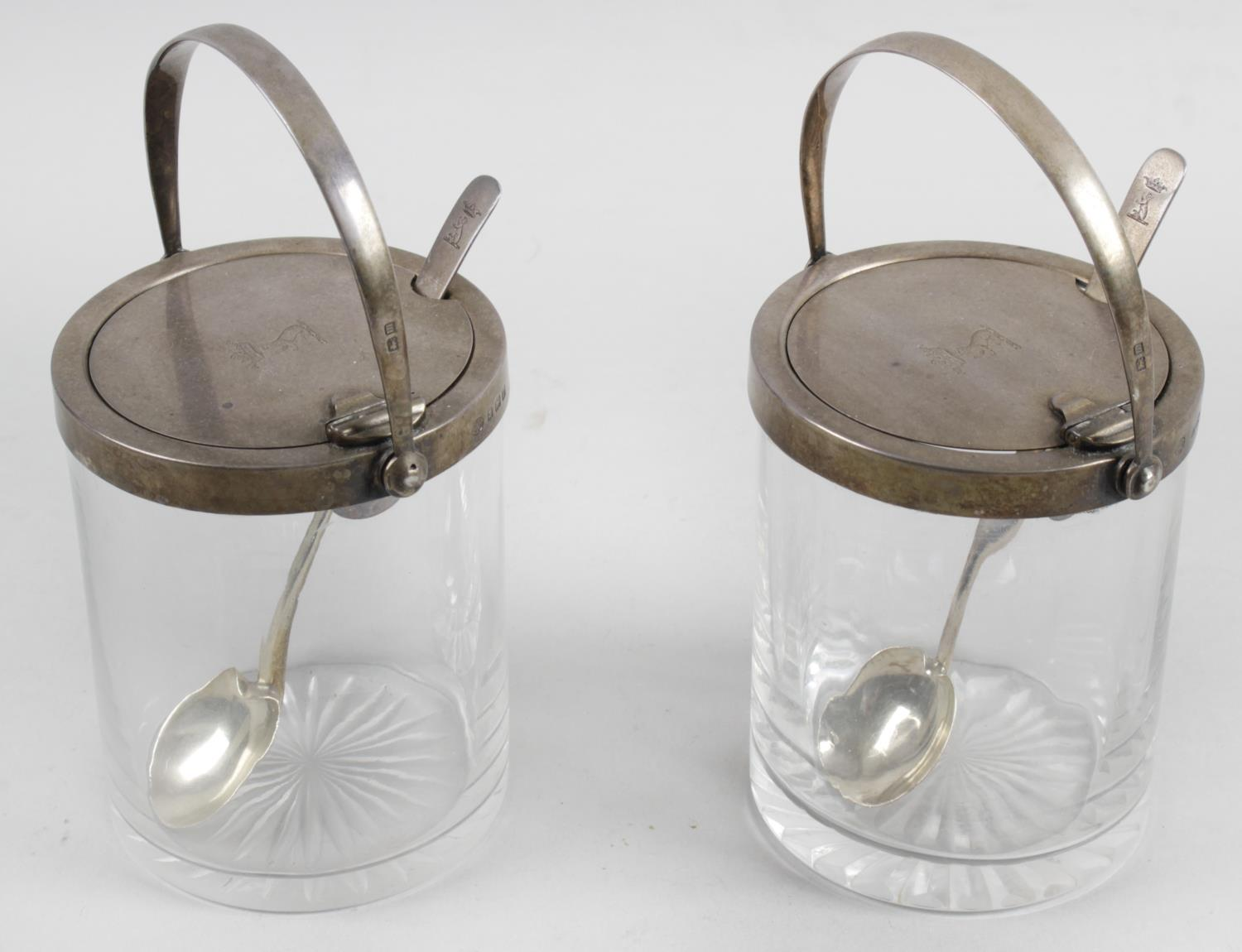 Lot 49 - A pair of glass preserve pots and covers,