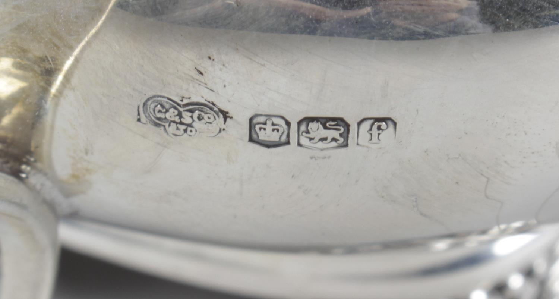 Lot 25 - A 1920's silver twin-handled sugar bowl and matching cream jug,