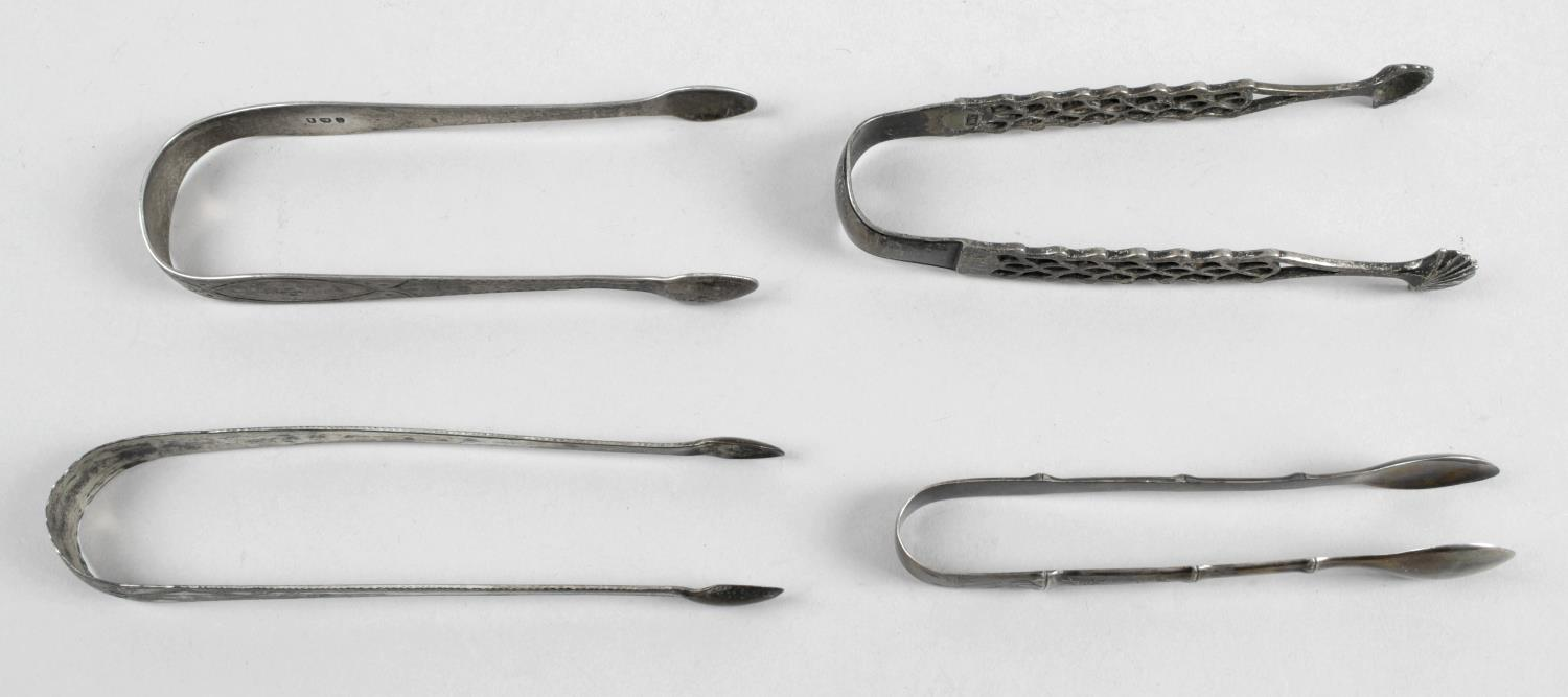 Lot 133 - A pair of George III silver sugar tongs with engraved detail to stems,