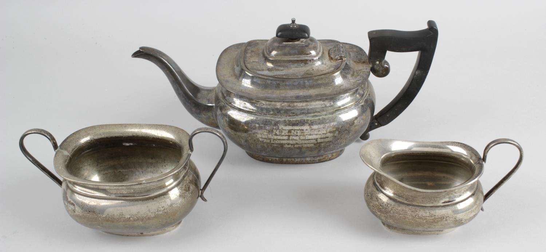Lot 180 - A 1930's silver three piece tea service,