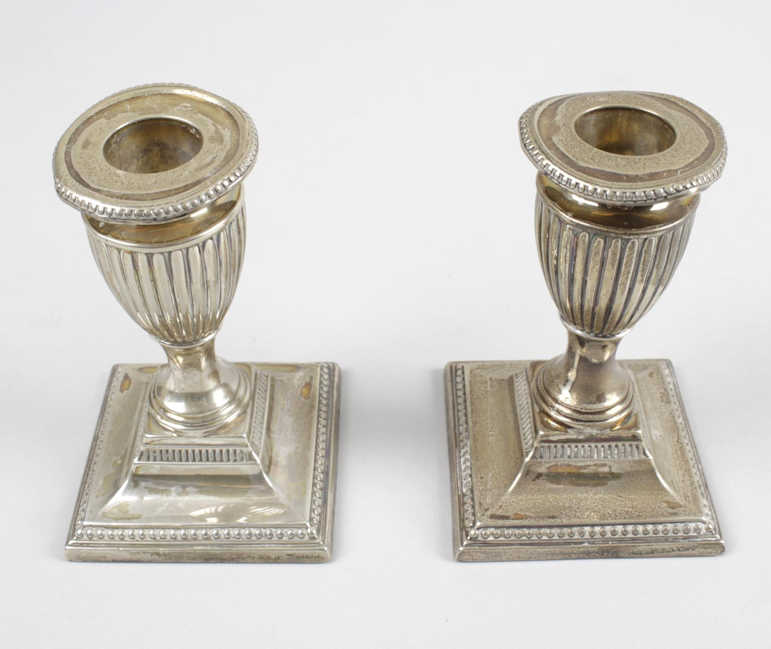 Lot 41 - A pair of Edwardian silver mounted dwarf candlesticks,