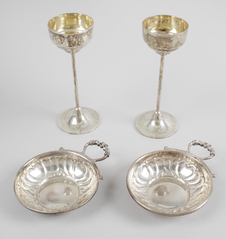 Lot 131 - A near pair of modern silver wine tasters,