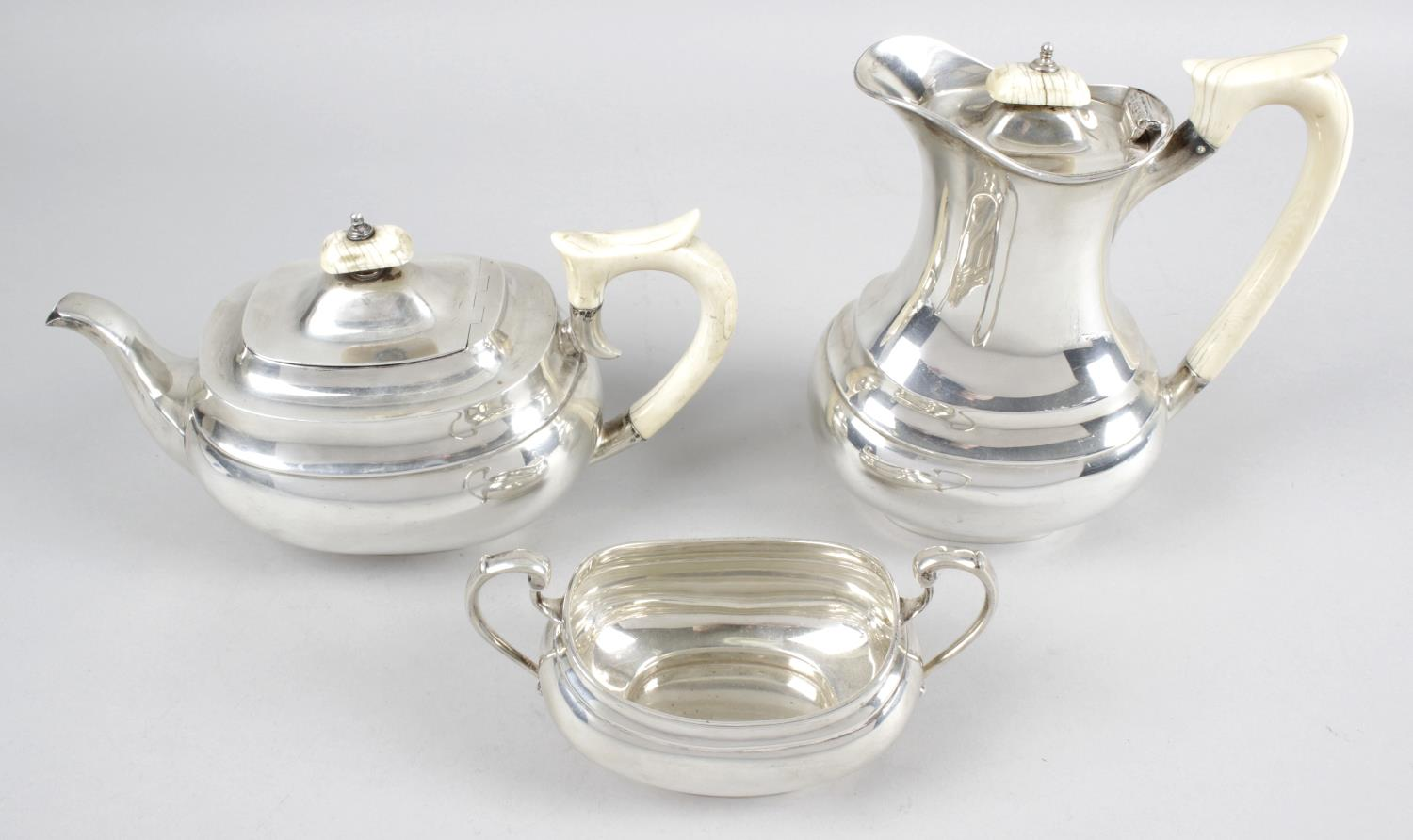 Lot 125 - A 1930's silver three piece tea service,