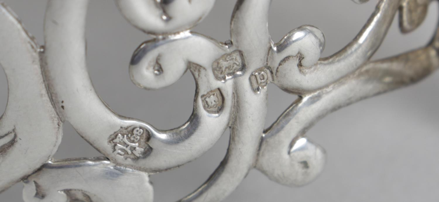 Lot 136 - A late Victorian silver cup holder with foliate scroll pierced decoration to the whole and beaded