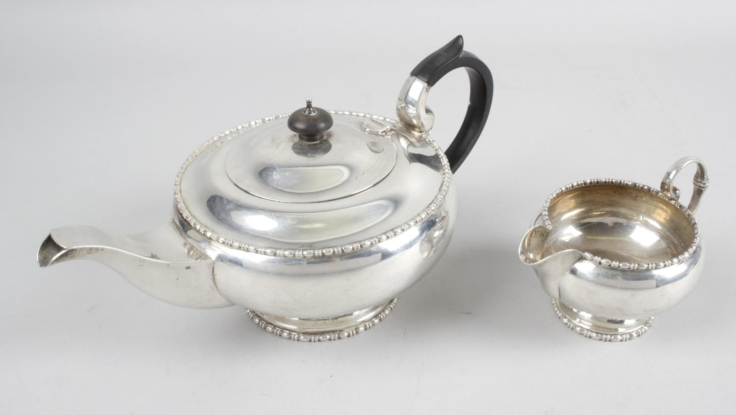 Lot 85 - A George V silver teapot,