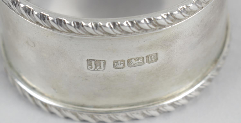 Lot 151 - A part set of eleven George V silver Fiddle pattern dessert spoons,