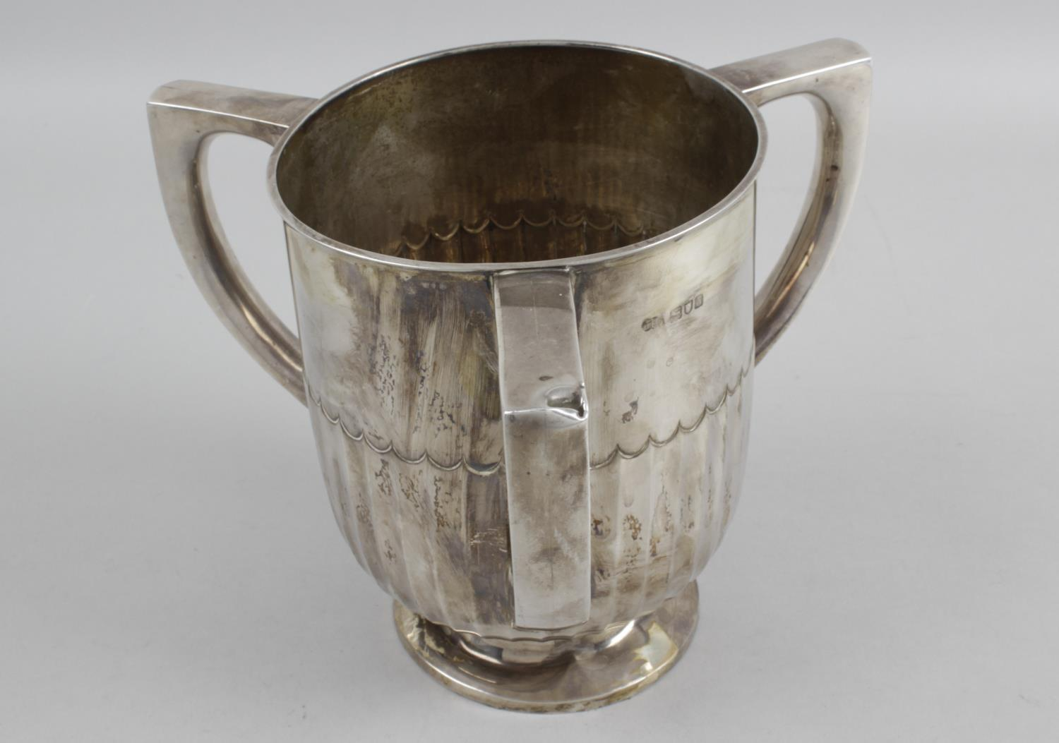 Lot 129 - A late nineteenth century silver three-handled cup,