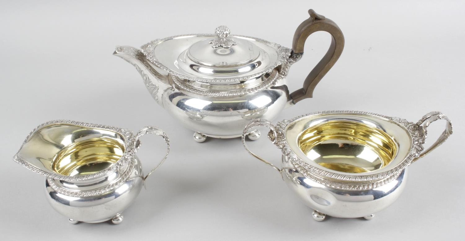 Lot 79 - An early George V silver three piece tea service in Regency style,