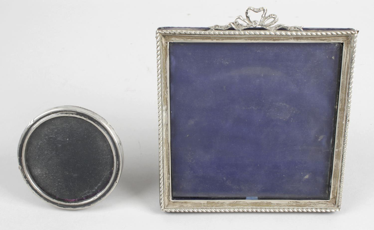 Lot 152 - An Edwardian silver mounted photograph frame of square easel back form,