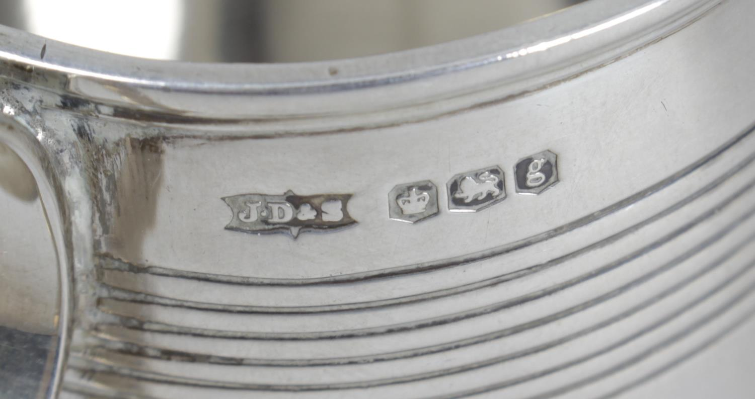 Lot 145 - Two 1920's silver christening mugs,