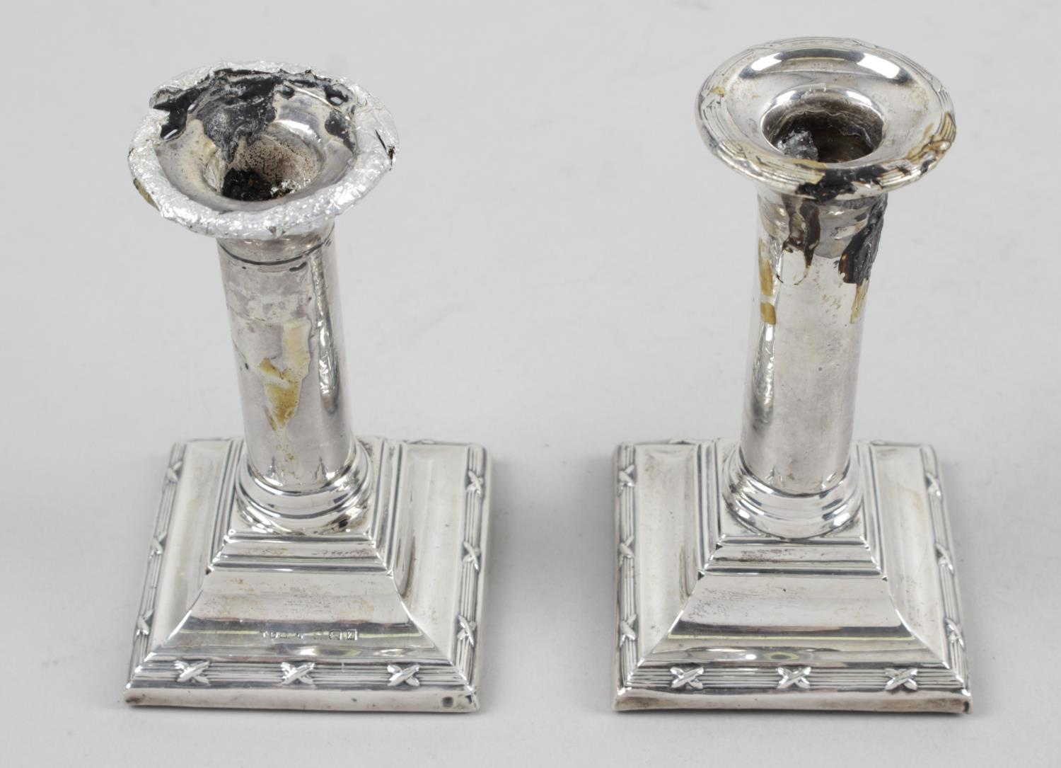 Lot 172 - A pair of modern silver mounted candlesticks,