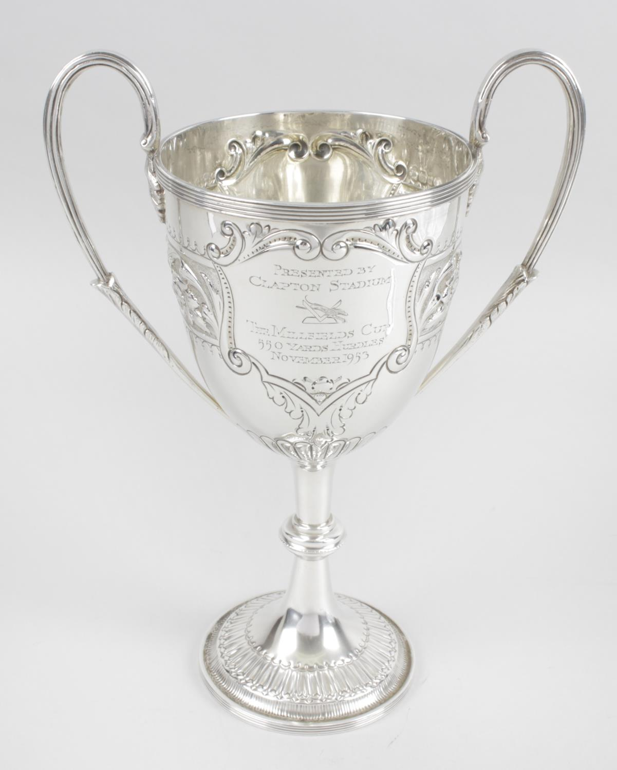 Lot 29 - An Edwardian silver twin-handled trophy cup,