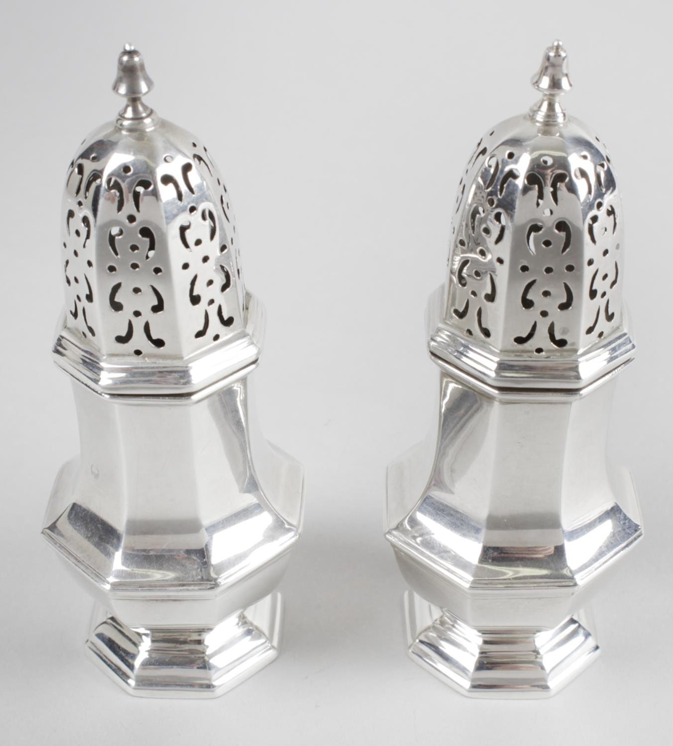 Lot 20 - A pair of late Victorian silver pepper casters,