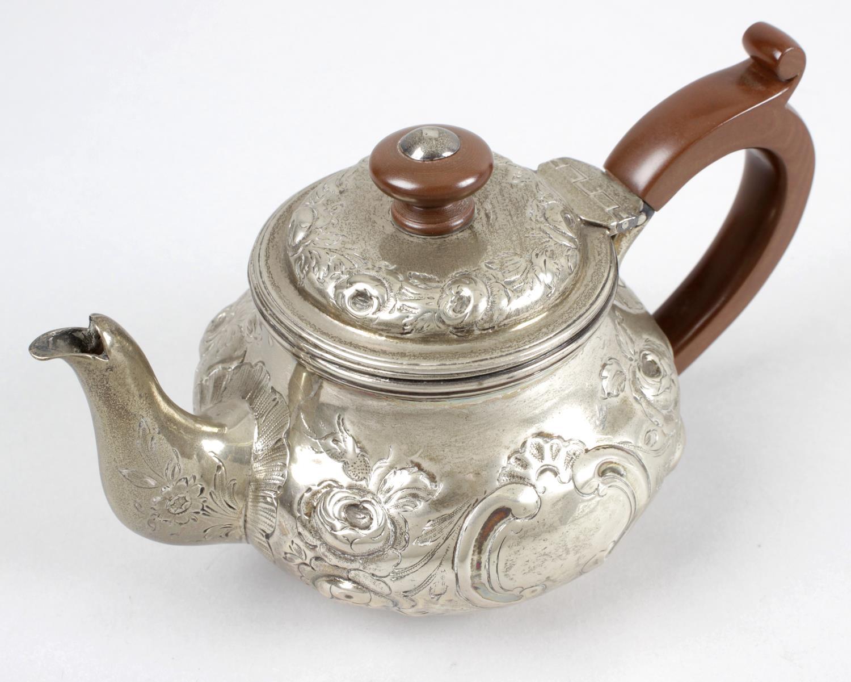 Lot 2 - A George III silver bachelor teapot,