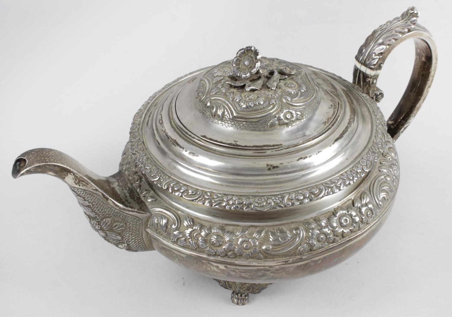 Lot 12 - A George IV Scottish silver teapot,