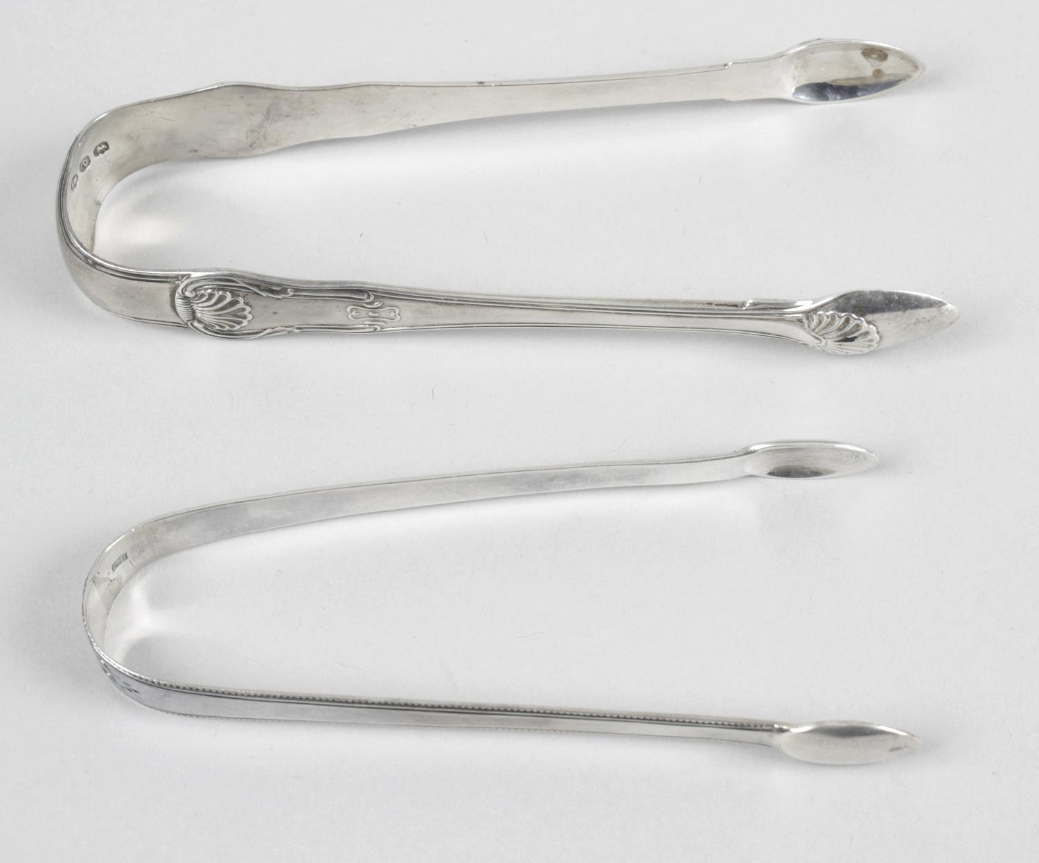 Lot 45 - A pair of George III silver sugar tongs with dentil style edge,