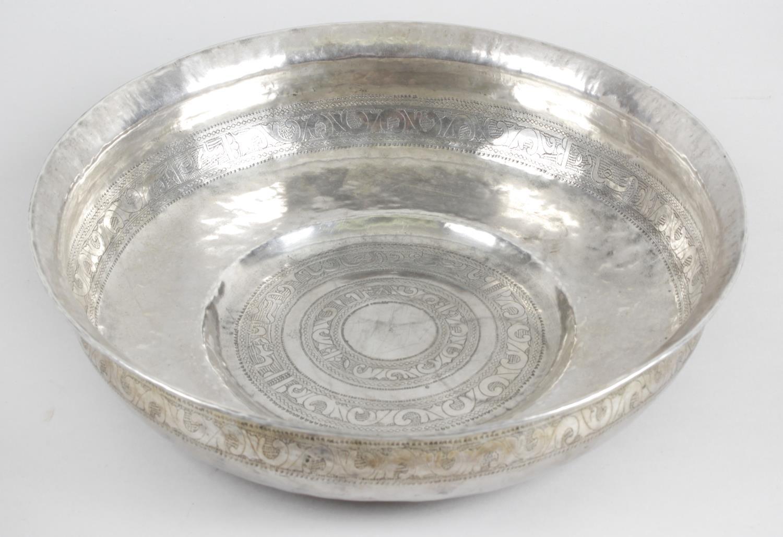 Lot 179 - An Eastern white metal shallow bowl,