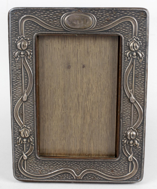 Lot 34 - An early twentieth century Art Nouveau silver mounted photograph frame,