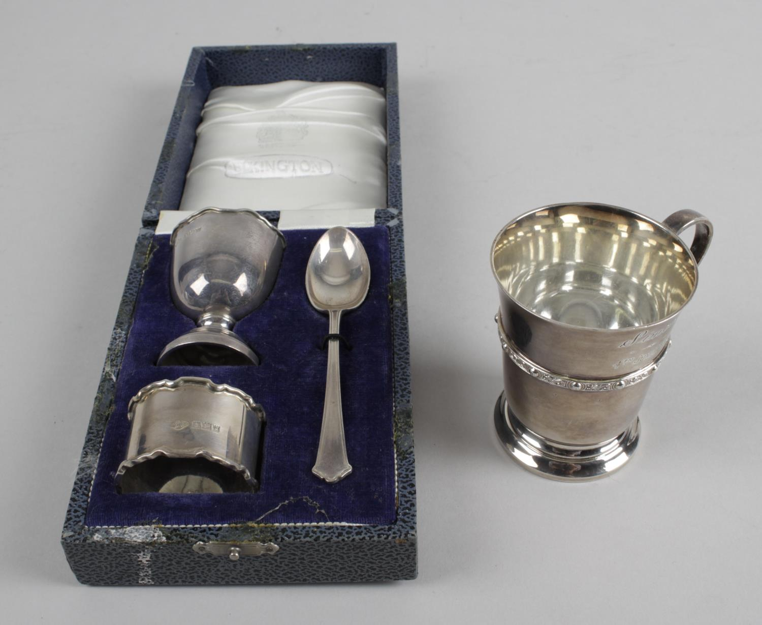 Lot 148 - A cased set of six 1920's silver coffee spoons with coffee bean terminals,